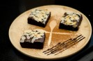Brownie placing on a decorated wooden plate